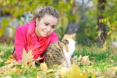 Attractive girl and cat on nature Royalty Free Stock Image
