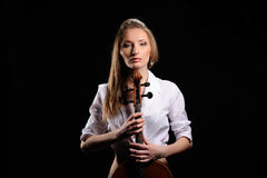 Attractive girl with cello isolated. Over black background stock image