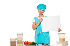 Attractive girl chef with a white plate. Isolated Royalty Free Stock Image
