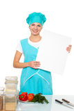 Attractive girl chef with a white plate. Isolated Stock Photos