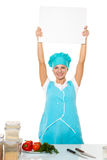 Attractive girl chef with a white plate. Isolated Royalty Free Stock Photos