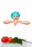 Attractive girl chef with a white plate. Isolated Stock Photography