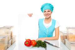 Attractive girl chef with a white plate. Isolated Stock Photo