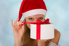 Attractive girl with Christmas present. Pretty young girl with a Christmas present in hand royalty free stock photo