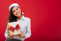 Attractive girl with Christmas present Royalty Free Stock Image