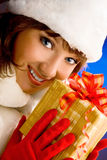 Attractive Girl with Christmas Prezent in a White Fur Coat and H Stock Images