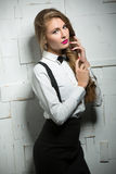 Attractive girl in classic trouser suit with Royalty Free Stock Photo