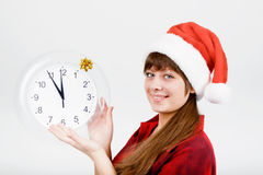 Attractive girl with a clock Stock Photography