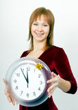Attractive girl with a clock Stock Images
