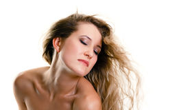Attractive girl with closed eyes and flying hair. white backgrou Royalty Free Stock Image