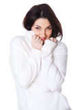 Attractive girl closes sweater face Stock Photo