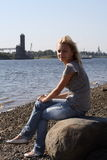 The attractive girl on coast. Royalty Free Stock Photography