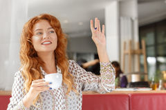 Attractive girl on coffee break. Attractive red-haired girl on coffee break in cafe Stock Photos