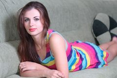 Attractive girl on the couch in the  room Royalty Free Stock Photos