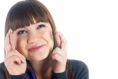 Attractive girl with crossed fingers Royalty Free Stock Image
