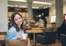 Attractive girl with a cup royalty free stock photos