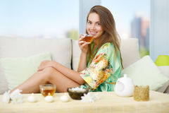 An attractive girl with a cup of tea Stock Image
