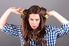 Attractive girl with curlers. Portrait of attractive girl with curlers stock photos