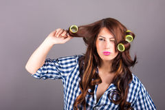 Attractive girl with curlers. Portrait of attractive girl with curlers royalty free stock image