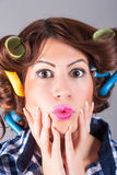 Attractive girl with curlers. Portrait of attractive girl with curlers stock photo
