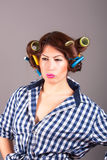 Attractive girl with curlers. Portrait of girl with curlers stock photography