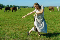Attractive girl dance on meadow Stock Image