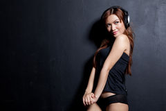 Attractive girl dancing with headphones Royalty Free Stock Images