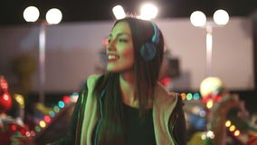 Attractive girl dancing to the rhythm of music with headphones stock footage