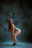 Attractive girl dancing twerk in the studio. Attractive girl dancing twerk iat the blue studio background stock images