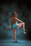 Attractive girl dancing twerk in the studio. Attractive girl dancing twerk iat the blue studio background royalty free stock photo