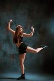 Attractive girl dancing twerk in the studio. Attractive girl dancing twerk iat the blue studio background royalty free stock photography