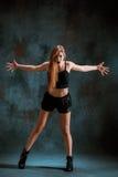 Attractive girl dancing twerk in the studio. Attractive girl dancing twerk iat the blue studio background royalty free stock image