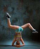 Attractive girl dancing twerk in the studio. Attractive girl dancing twerk iat the blue studio background stock photography