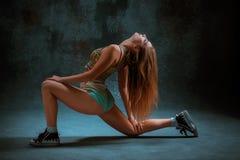 Attractive girl dancing twerk in the studio. Attractive girl dancing twerk iat the blue studio background royalty free stock images