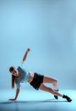 Attractive girl dancing twerk in the studio. Attractive girl dancing twerk iat the blue studio background stock photos