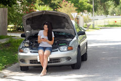 Attractive Girl with Disabled Car (3) Stock Photo