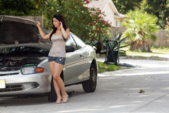 Attractive Girl with Disabled Car (4) Stock Photo