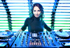 Attractive girl DJ in the nightclub Royalty Free Stock Photography