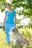 Attractive girl with dog Royalty Free Stock Photo