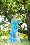 Attractive girl with dog Royalty Free Stock Images