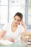 Attractive girl doing homework Royalty Free Stock Photography