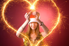 Attractive girl drawing heart Stock Photography