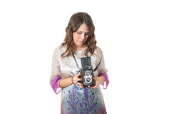 Attractive girl in dress holding a film camera Royalty Free Stock Photography