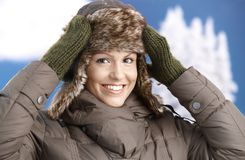 Attractive girl dressed up for winter fun smiling Stock Photo