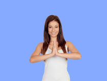 Attractive girl dressed in white practicing yoga Stock Image