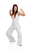 Attractive girl dressed in white practicing yoga Royalty Free Stock Photo