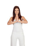 Attractive girl dressed in white practicing yoga Stock Photos