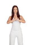 Attractive girl dressed in white practicing yoga Royalty Free Stock Image
