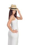 Attractive girl dressed in white with straw hat Stock Photography