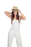Attractive girl dressed in white with straw hat Royalty Free Stock Image